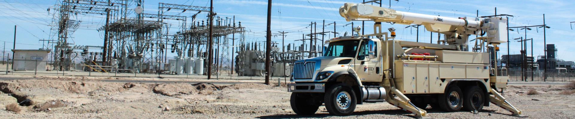 iid line truck in front of niland turbines